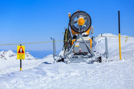 cantons: Mt. Titlis, Switzerland - 9 March, 2016: snow cannon on the top of the mountain. Titlis is a mountain of the Uri Alps, located on the border between the cantons of Obwalden and Bern.