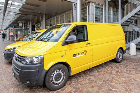 public company: Wallisellen, Switzerland - 13 November, 2015: Swiss Post vans parked at the Glatt shopping center. Swiss Post provides postal services in Switzerland, it is a public company owned by the Swiss Confederation and the countrys second largest employer. Editorial