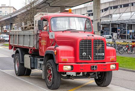 ber: Wallisellen, Switzerland - 13 November, 2015: Saurer D330B truck on the Neue Winterthurestrasse street. Saurer trucks were manufactured by Adolph Saurer AG, based in Arbon, Switzerland, which was a manufacturer of trucks and buses under the Saurer and Ber Editorial