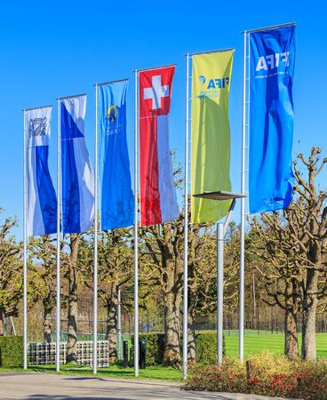 headquarter: Zurich, Switzerland - 11 April, 2016: flags at the entrance of the FIFA headquarter. FIFA (International Federation of Association Football) is the international governing body of association football (soccer), futsal and beach soccer. FIFA is responsible