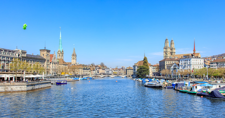 grossmunster cathedral: Zurich, Switzerland - 11 April, 2016: view along the Limmat river from the Quaibruecke bridge. Zurich is the largest city in Switzerland and the capital of the Swiss canton of Zurich.