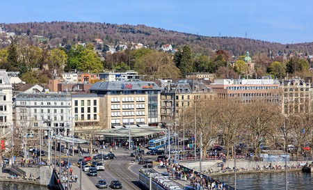temporarily: Zurich, Switzerland - 10 April, 2016: pedestrians and traffic on Quaibruecke bridge and Bellevue square, view from the Ferris wheel temporarily installed on Burkliplatz square. Zurich is the largest city in Switzerland and the capital of the Swiss canton  Editorial