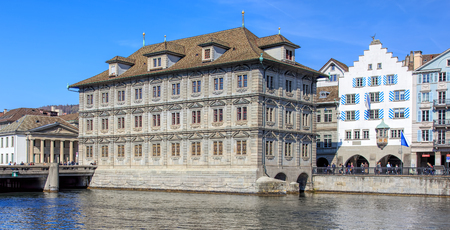 Zurich, Switzerland - 10 April, 2016: the Rathaus building with the Rathaus police station (German: Rathausposten) in the background. The Rathaus in Zurich is Zurichs Town Hall, it was built from 1694-1698 and houses both legislative chambers - the canto Editorial