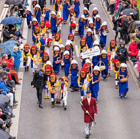 safran: Zurich, Switzerland - 17 April, 2016: representatives of the city of Lucerne participating in childrens parade (German: Kinderumzug) devoted to the upcoming Sechselauten festivity passing along Uranistrasse street. The Sechselauten is a traditional sprin