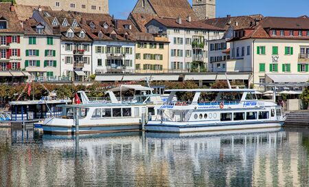st gallen: Rapperswil, Switzerland - 8 September, 2015: boats at pier on Seequai quay with old town buildings in the background. Rapperswil is a part of the municipality of Rapperswil-Jona in the Swiss canton of St. Gallen, located at the east side of the Lake Zuric