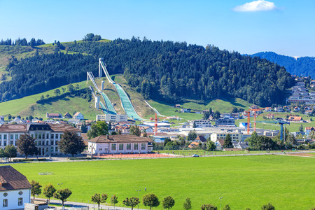 venue: Einsiedeln, Switzerland - 8 September, 2015: view on the town with the ski jumping venue. The ski jumping venue in Eschbach, Einsiedeln was built in 2001. In 2010 the venue became the National Ski jumping venue of Switzerland. Editorial