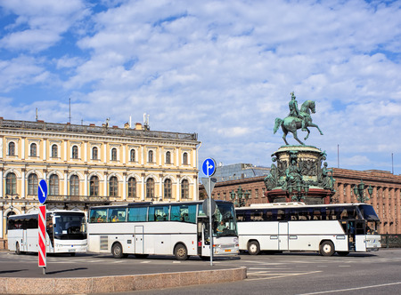 nikolay: Saint Petersburg, Russia - 9 July, 2015: tourist buses parked at the monument to Tsar Nikolay I on St. Isaacs square. Saint Petersburg is the second largest city in Russia, founded by Tsar Peter the Great in 1703. Editorial