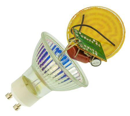 internals: Poor quality LED bulb that fell into parts, isolated on white background.