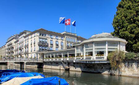 johannes: Zurich, Switzerland - 20 April, 2016: the Baur au Lac Hotel building decorated with flags of Zurich and Switzerland, view from Am Schanzengraben embankment. The Baur au Lac Hotel is a luxury hotel in Zurich, Switzerland, founded in 1844 by Johannes Baur.