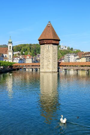 jesuit: View on the Reuss river in Lucerne, Switzerland with the famous city landmarks - the Jesuit church, the Water Tower and the Chapel bridge.