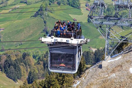 top 7: Mt. Stansenhorn, Switzerland - 7 May, 2016: people in a gondola of the Stansenhorn Cabrio cable car approaching the station on the top of the mountain. Stansenhorn Cabrio is the the worlds first double deck open top cable car, it carries 60 passengers pe
