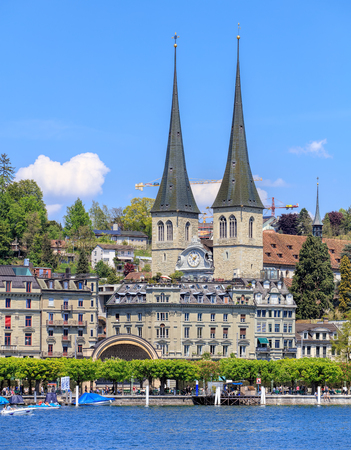 st german: Lucerne, Switzerland - 8 May, 2016: view on Kurplatz square from Bahnhofquai with the towers of the Church of St. Leodegar in the background. The Church of St. Leodegar (German: St. Leodegar im Hof or Hofkirche St. Leodegar) is the most important church a