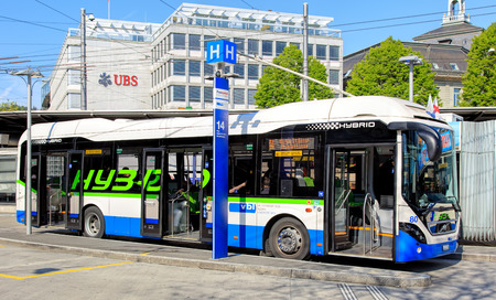 Lucerne, Switzerland - 7 May, 2016: VBL hybrid bus on bus stop on Bahnhofplatz square. Lucerne Transit Agency (German: Verkehrsbetriebe Luzern or VBL) is the main provider of public transport in the city of Lucerne. Lucerne is a city in central Switzerlan Editorial