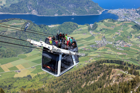 top 7: Mt. Stanserhorn, Switzerland - 7 May, 2016: people in a gondola of the Stanserhorn Cabrio cable car. Stanserhorn Cabrio is the the worlds first double deck open top cable car, it carries 60 passengers per cabin with room for 30 on the open deck. Stanserh