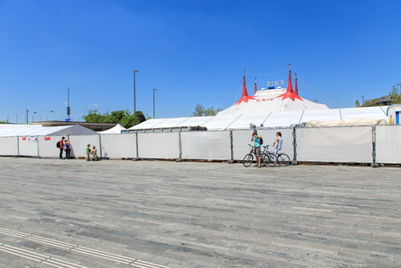 temporarily: Zurich, Switzerland - 26 May, 2016: people at the fence of Circus Knie temporarily installed on Sechselautenplatz square. Circus Knie is the largest circus of Switzerland, based in Rapperswil, founded in 1803 by the Knie family. Editorial