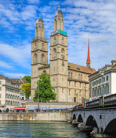 farbe: Zurich, Switzerland - 26 May, 2016: towers of the Grossmunster cathedral with the Farbe bekennen banner. The banner is part of the promotion devoted to the World Refugee Day on 20th June, arranged by aid organization of Evangelic Churches of Switzerland