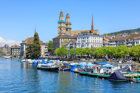 grossmunster cathedral: Zurich, Switzerland - 26 May, 2016: view on the Limmatquai quay from the Quaibruecke bridge. Zurich is the largest city in Switzerland and the capital of the Swiss canton of Zurich. Editorial