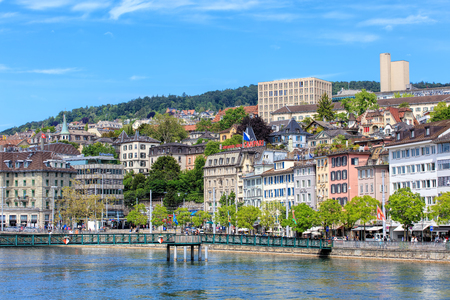 central square: Zurich, Switzerland - 25 May, 2016: Muehlesteg footbridge over the Limmat river, people and buildings on the Limmatquai quay and Central square. Zurich is the largest city in Switzerland and the capital of the Swiss canton of Zurich.