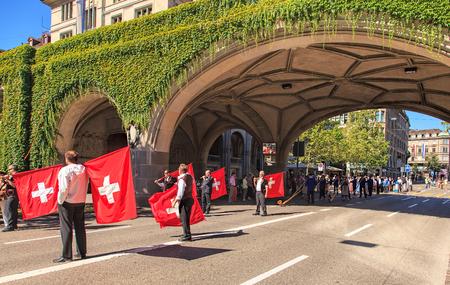 alphorn: Zurich, Switzerland - 1 August, 2013: participants of the parade devoted to the Swiss National Day on Uraniastrasse street. The Swiss National Day (German: Schweizer Bundesfeier) is the national holiday of Switzerland, celebrated on the 1st August.