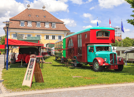 broadway show: Zug, Switzerland - 5 June, 2014: Broadway Variete truck and tents. Broadway Variete is a traveling Swiss theater, established in 1947, where spectators can watch a show while enjoying a 3-course dinner. Editorial