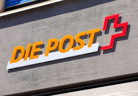 public company: Aarau, Switzerland - 7 July, 2016: Swiss Post sign on the wall of a post office. Swiss Post a public company owned by the Swiss Confederation, which provides national postal service for Switzerland, it is the countrys second largest employer. Editorial
