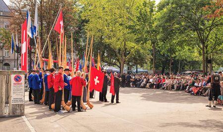alphorn: Zurich, Switzerland - 1 August, 2014: people on Burkliplatz square listening to the speech devoted to the Swiss National Day. The Swiss National Day (German: Schweizer Bundesfeier) is the national holiday of Switzerland, celebrated on the 1st August.