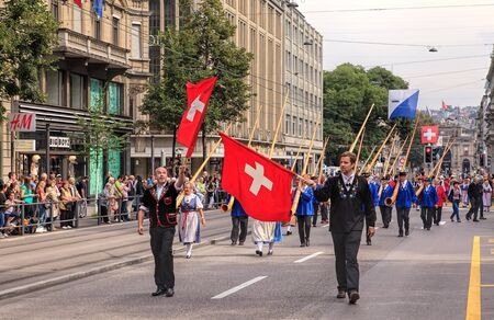 alphorn: Zurich, Switzerland - 1 August, 2014: participants of the parade devoted to the Swiss National Day passing along Bahnhofstrasse street. The Swiss National Day (German: Schweizer Bundesfeier) is the national holiday of Switzerland, celebrated on the 1st Au
