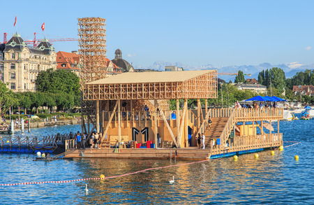 18 20: Zurich, Switzerland - 20 July, 2016: Pavillon of Reflections on Lake Zurich. The Pavillon of Reflections is a floating island with an open-air cinema and swimming pool. It was built for Manifesta 11 taking place in Zurich from 11 June to 18 September 2016