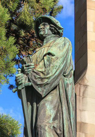 heinrich: Upper part of the statue of Ulrich Zwingli at the Water Church (German: Wasserkirche) in Zurich, Switzerland. The bronze statue by sculptor Heinrich Natter was unveiled in 1885.