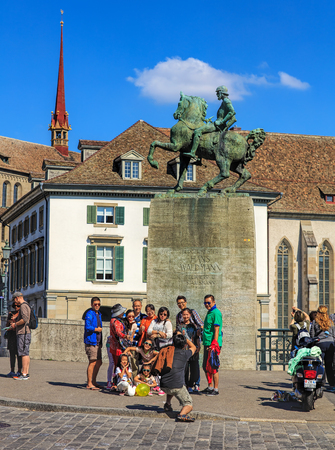 hans: Zurich, Switzerland - 21 August, 2015: tourists at the monument to Hans Waldmann in the historic part of the city. Zurich is the largest city in Switzerland, it is also the capital of the Swiss canton of Zurich. Editorial