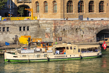 empties: Basel, Switzerland - 27 August, 2016: Froschkoenig boat at pier on the Rhine river, view from the Mittlere Bruecke bridge. The Rhine is a European river that begins in the Swiss canton of Graubuenden and empties into the North Sea in the Netherlands. Editorial