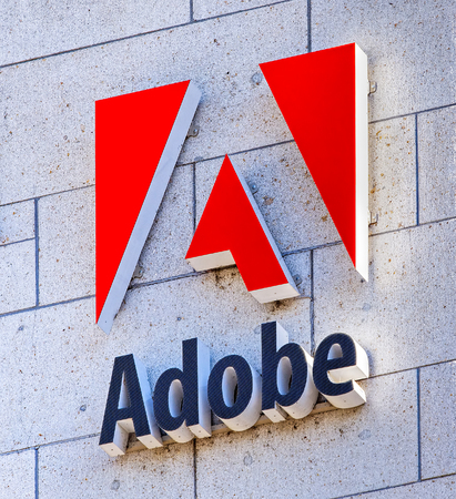 software company: Basel, Switzerland - 27 August, 2016: Adobe sign on the wall of an office building. Adobe Systems Incorporated is an American multinational computer software company, headquartered in San Jose, California.