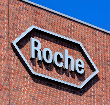 pharmaceutic: Basel, Switzerland - 27 August, 2016: Roche sign on the wall of an office building. Roche Holding AG operates in the pharmaceuticals and diagnostics businesses in Europe, North America and Asia.