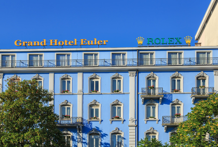 boasting: Basel, Switzerland - 27 August, 2016: upper part of the Grand Hotel Euler building facade. Euler Hotel Basel is a newly refurbished 4-star hotel boasting first-class traditional hotel culture for over 140 years, located right at the Basel train station.