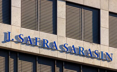 bank owned: Basel, Switzerland - 27 August, 2016: J. Safra Sarasin sign on the wall of the office building. Bank J. Safra Sarasin AG is a Swiss private bank, founded in 1841 and headquartered in Basel. It is currently owned by the Brazilian Safra Group.