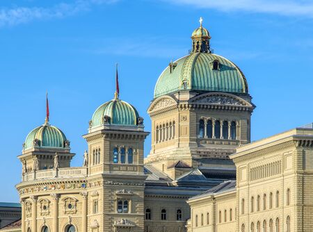 Bern, Switzerland - 29 December, 2015: upper part of the Federal Palace of Switzerland building. The Federal Palace is a governmental building, in which the Swiss Federal Assembly (federal parliament) and the Federal Council are housed.