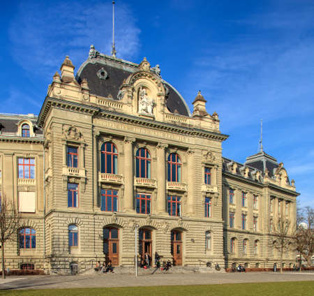 Bern, Switzerland - 29 December, 2015: the University of Bern building, people at the entrance to it. The University of Bern is a university in the city of Bern, founded in 1834, regulated and financed by the Swiss Canton of Bern.