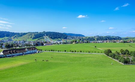 venue: Einsiedeln, Switzerland - 8 September, 2015: view on the town with the ski jumping venue in the background. The ski jumping venue in Eschbach, Einsiedeln was built in 2001. In 2010 the venue became the National Ski jumping venue of Switzerland.
