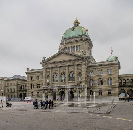 governmental: Bern, Switzerland - 19 October, 2015: view with the Federal Palace of Switzerland building on an overcast day, view from Bundesplatz square. The Federal Palace of Switzerland (German: Bundeshaus) is the building in Bern in which the Swiss Federal Assembly Editorial