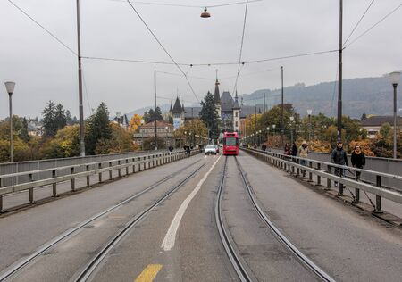 helvetia: Bern, Switzerland - 19 October, 2015: view along the Kirchenfeldbrucke bridge towards Helvetiaplatz square on an overcast autumn day. The Kirchenfeldbrucke is a bridge over the Aare river, connecting Casinoplatz square in the citys old town with Helvetia