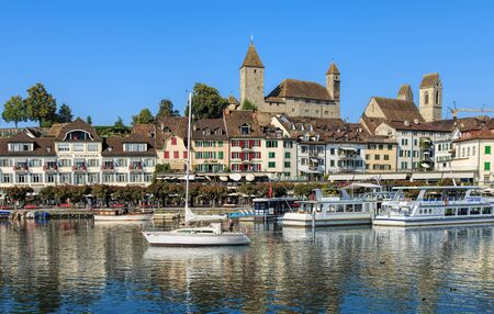 Rapperswil, Switzerland - 12 September, 2016: boats on Lake Zurich with historic buildings in the background. Rapperswil  is a part of the municipality of Rapperswil-Jona in the Swiss canton of St. Gallen, located on the east side of Lake Zurich. Editorial