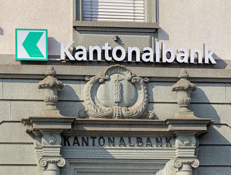 Rapperswil, Switzerland - 12 September, 2016: sign and relief on the wall of an St. Gallen Cantonal bank office. Cantonal banks are Swiss government-owned commercial banks, which are provided by the canton in which they are based with a guarantee for the