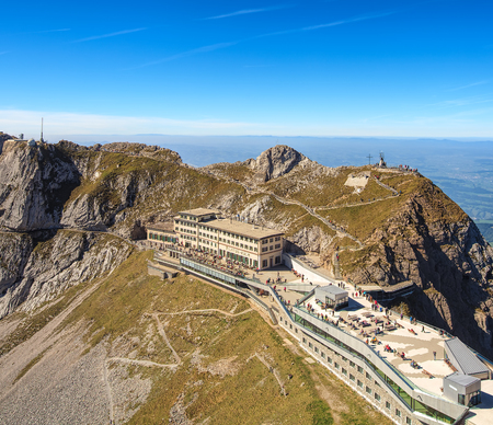 rack mount: Mt. Pilatus, Switzerland - 23 September, 2014: people and buildings on the mountain. Mount Pilatus is a mountain overlooking Lucerne in central Switzerland, its top can be reached with the Pilatus railway, the worlds steepest rack railway.