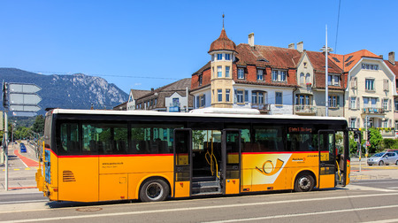 Solothurn, Swizerland - 10 July, 2016: PostBus on Bahnhofplatz square. PostBus Switzerland (known as PostAuto in German) is a subsidiary company of the Swiss Post, which provides regional and rural bus services throughout Switzerland, and also in France a