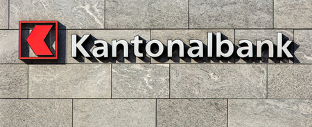 Einsiedeln, Switzerland - 7 September, 2015: sign on the wall of a Cantonal Bank of Schwyz (German: Schwyzer Kantonalbank) office. Cantonal banks are Swiss state-owned commercial banks, which are provided with a guarantee for the assets held there by the  Editorial