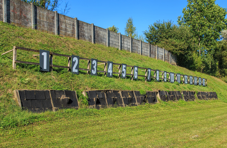 common target: Target numbers on a shooting range in Switzerland. Shooting ranges in Switzerland are common due to the liberal gun laws and strong shooting traditions existing in Switzerland. Stock Photo