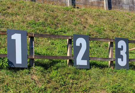 Target numbers on a shooting range in Switzerland. Shooting ranges in Switzerland are common due to the liberal gun laws and strong shooting traditions existing in Switzerland. Stock Photo
