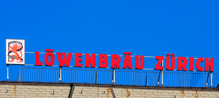 bier: Zurich, Switzerland - 25 August, 2016: promotion of Lowenbrau Zurich on the top of a building on the Limmatquai quay. Lowenbrau Zurich AG was a brewery in the Swiss city of Zurich, which closed its production in 1986.