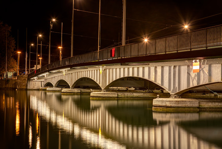 Quaibruecke bridge in the Swiss city of Zurich at night. A HDR (high dynamic range) image with tone mapping applied. Stock fotó - 64170042