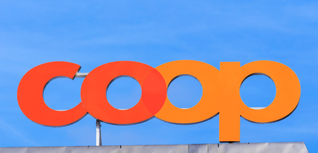 Zurich, Switzerland - 18 January, 2016: Coop sign on the top of a Coop department store building. Coop Cooperative is one of Switzerlands largest retail and wholesale companies, it is structured in the form of a cooperative society with around 2.5 millio Editorial